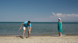Couple playing bat and ball at the beach Stock Video Footage