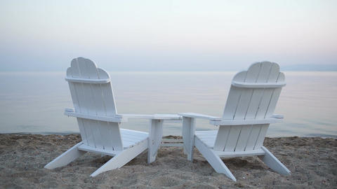 Empty wooden deck chairs on a beach Stock Video Footage