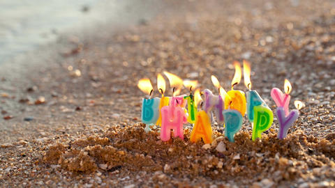 Birthday candles burning on a seashore Stock Video Footage