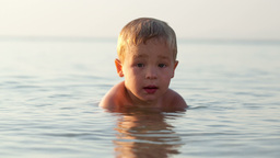 Smiling little boy in the sea Footage