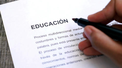 Circling Education with a pen (In Spanish) Stock Video Footage