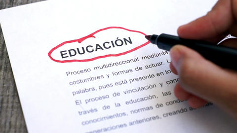Circling Education with a pen (In Spanish) Footage