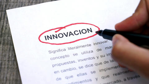 Circling Innovation with a pen (In Spanish) Stock Video Footage
