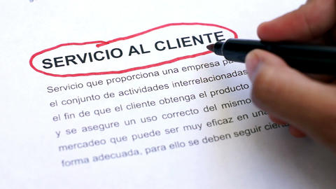 Circling Customer Service with a pen (In Spanish) Footage