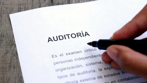 Circling Audit with a pen (In Spanish) Stock Video Footage