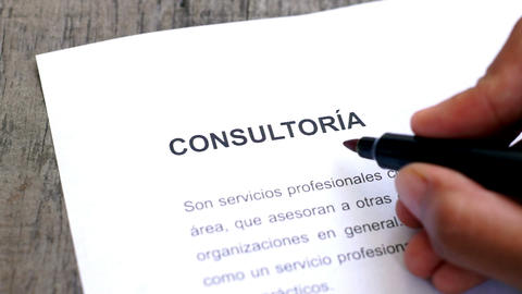 Circling Consulting with a pen (In Spanish) Stock Video Footage