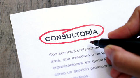 Circling Consulting with a pen (In Spanish) Footage