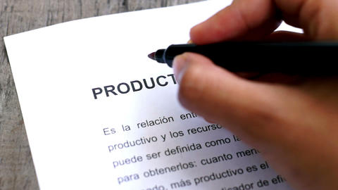 Circling Productivity with a pen (In Spanish) Stock Video Footage