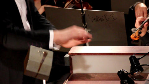 the hands of a man who conducts the orchestra Stock Video Footage
