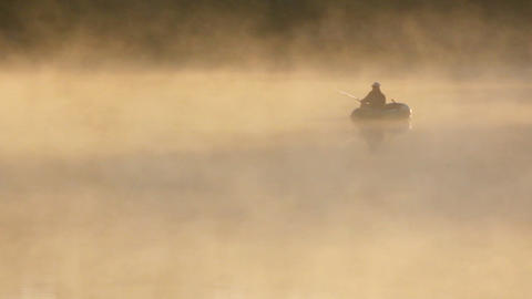 morning fishing on river in fog Stock Video Footage