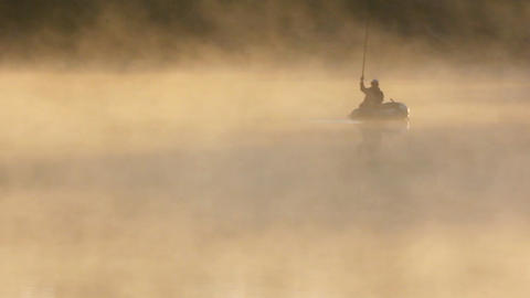 morning fishing on river in fog Footage