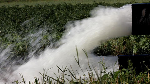 strong jet of water flowing from a large pipe - sl Stock Video Footage