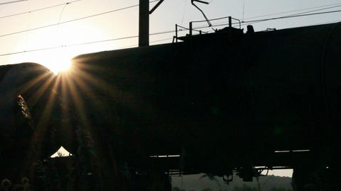 freight train against sunset - loopable Stock Video Footage