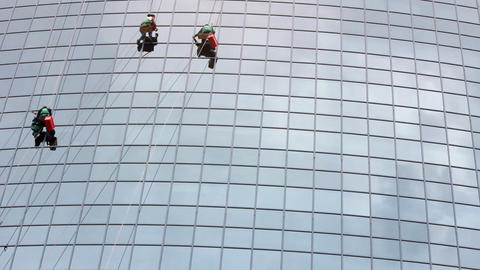 window cleaners at work on skyscraper Footage