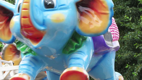 little girl riding on elephants carousel Stock Video Footage