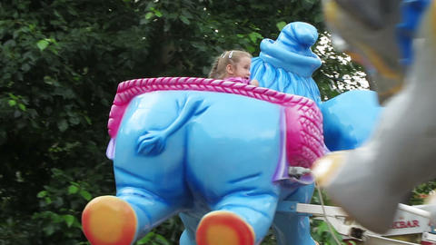 little girl riding on elephants carousel Footage