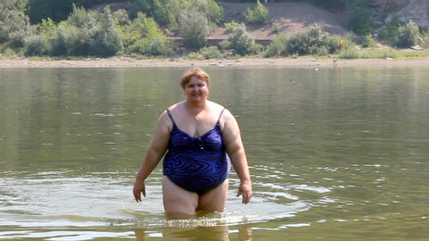 woman with overweight bath in river Footage
