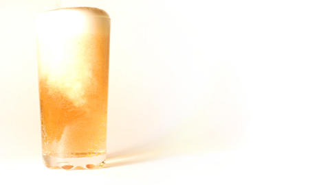beer is poured into a glass on white background - Stock Video Footage