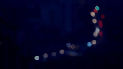traffic on night roads with headlights defocused Stock Video Footage