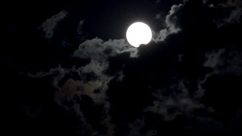 timelapse with moon moving between clouds Footage