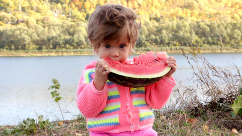 baby eating ripe watermelon Footage