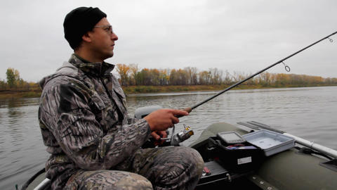 man fishing with spinning Stock Video Footage