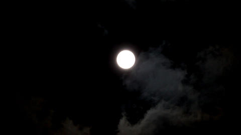timelapse with moon moving between clouds Stock Video Footage