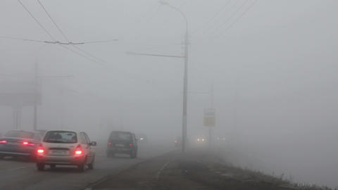 cars moving in the fog Stock Video Footage