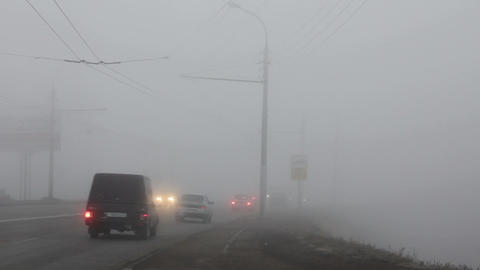 cars moving in the fog Footage