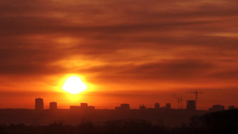sunrise over far town with fog Stock Video Footage