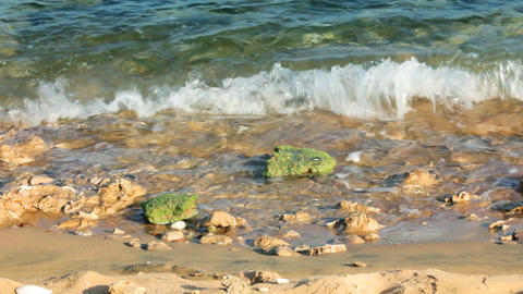 turquoise sea water waves and stones - timelapse Stock Video Footage