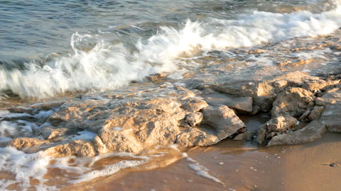 turquoise sea water waves and stones - timelapse Footage