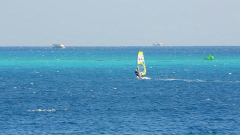 windsurfing - surfer on blue sea surface Stock Video Footage