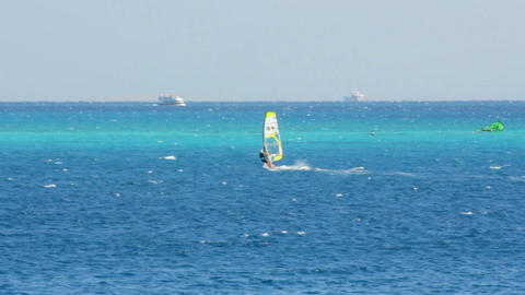 windsurfing - surfer on blue sea surface Footage