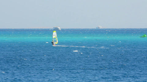 windsurfing - surfer on blue sea surface Stock Video Footage