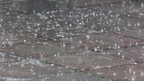 heavy rain drops on the pavement Stock Video Footage