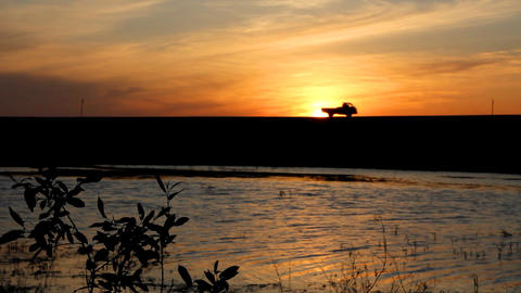 timelapse with lake and cars silhouettes against s Stock Video Footage