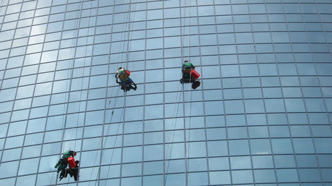 timelapse with window cleaners at work on skyscrap Footage