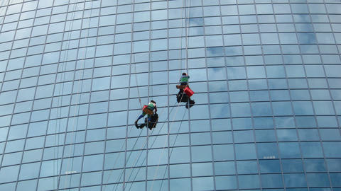 timelapse with window cleaners at work on skyscrap Stock Video Footage