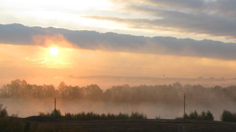 rural mist landscape with sunrise over lake Stock Video Footage