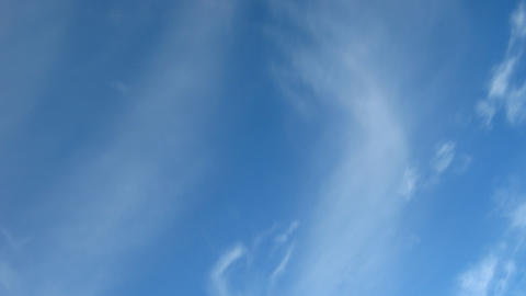 blue sky with moving fleecy clouds background Stock Video Footage