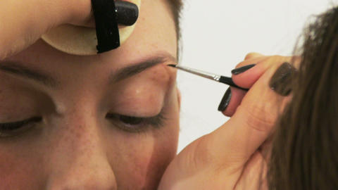 Woman having make up in beauty salon Stock Video Footage