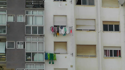 Hanging Clothes in Window South Europe 1 Stock Video Footage