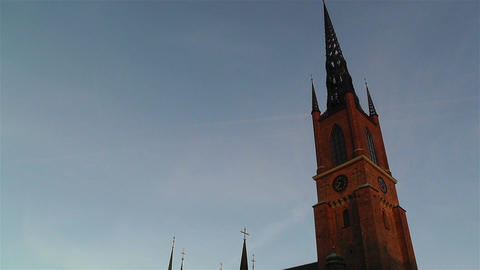 Stockholm Riddarholms Church 1 sunset tilt Stock Video Footage