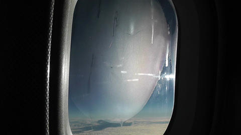View from Plane during Flight 3 icy window pov Stock Video Footage