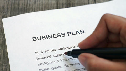 Circling Business Plan with a red marker Stock Video Footage