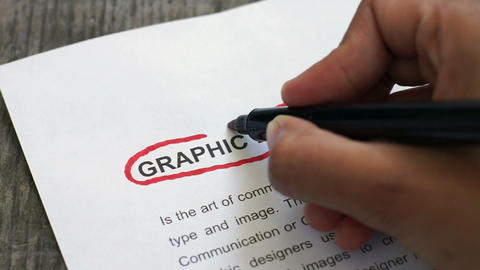 Circling Graphic Design With A Red Marker stock footage