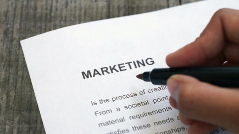 Circling Marketing with a red marker Stock Video Footage