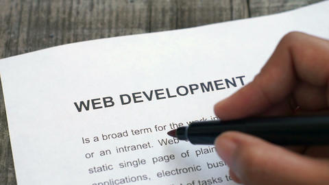 Circling Web Development with a red marker Stock Video Footage