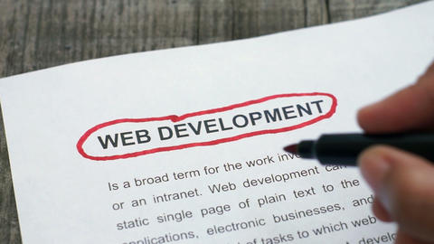 Circling Web Development with a red marker Footage